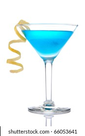 Blue tropical cocktail with lemon spiral isolated on a white background