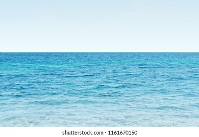 blue tropical sea ocean and clear sky background