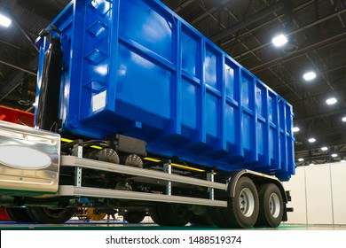 Blue truck body. The body of the truck for garbage collection. Demonstration of equipment for housing and communal services. Metal container for garbage collection.
