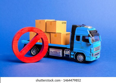 A blue truck loaded with boxes and a red symbol NO. Embargo trade wars. Restriction on importation, ban on export of dual-use goods to countries under sanctions. transport companies. Ban on transit