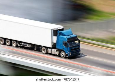 Blue truck on bridge with blurred background
