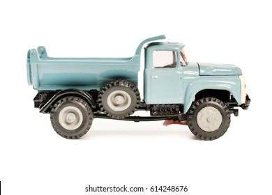 Blue truck toy retro car model on a white background. Isolated