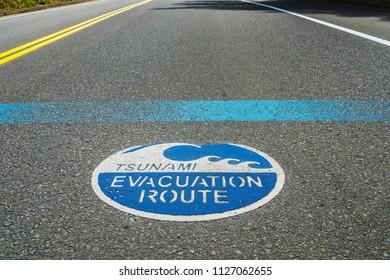 Blue Tsunami evacuation route road sign on the asphalt, Highway 101, Oregon, USA.
