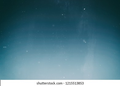 Blue, turquoise and aqua color. Retro photographic film effect. Abstract vintage gradient background.