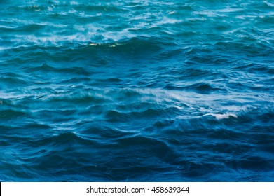 Blue and turquoise sea waves texture and background, blurred.