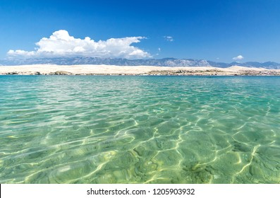 Blue turquoise water in front of island of Pag, Croatia, Europe
