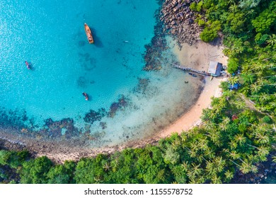 Blue turquoise water sea island with green tree summer vacation background by drone