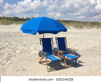 Blue umbrella on the beach.