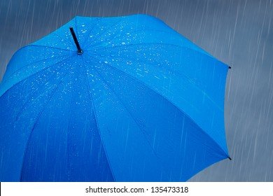 Blue umbrella in the rain