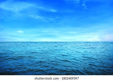 BLUE UNDER WATER waves and bubbles. Beautiful white clouds on blue sky over calm sea with sunlight reflection, Tranquil sea harmony of calm water surface. Sunny sky and calm blue ocean. - Shutterstock ID 1802409397