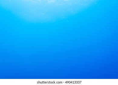 blue underwater background in the sea