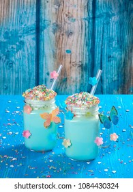 Blue unicorn hot chocolate with whipped cream, sugar and sprinkles