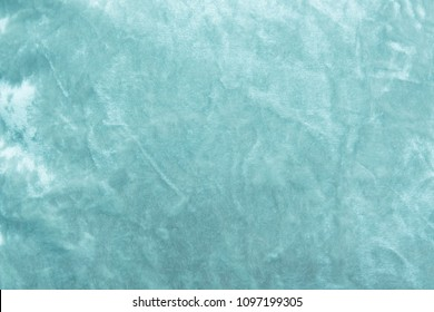 Blue velvet background or velor texture of cotton or wool with soft fluffy velvety fabric.