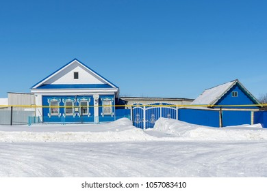 Blue village house in winter sunny day