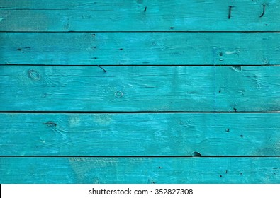 Blue vintage rustic aged painted wooden panel with horizontal planks