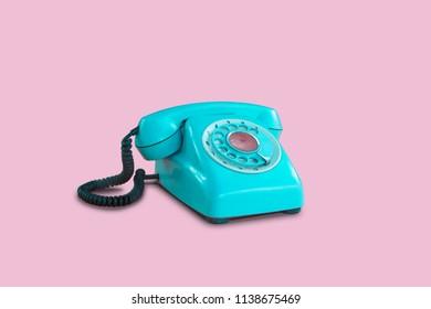 Blue vintage telephone on pink pastel color background. minimal idea concept