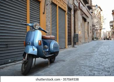 Blue vintage Vespa in old street