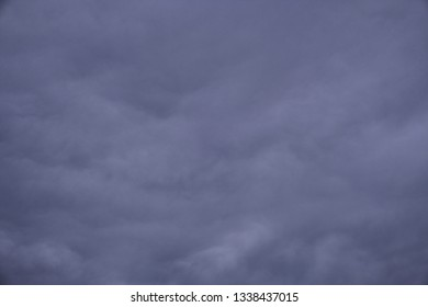 Blue violet with clouds overcast sky with or without vignette as background texture or wallpaper pattern.