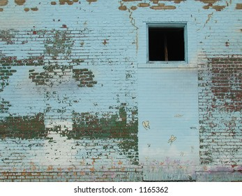 Blue wall with butterflies and flaky paint background or layer