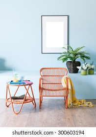 blue wall interior concept and wicker furniture