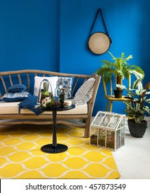 blue wall interior yellow rug and flower