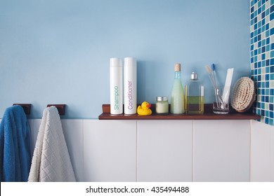 Blue wall and a shelf in the bathroom with hygiene accessories