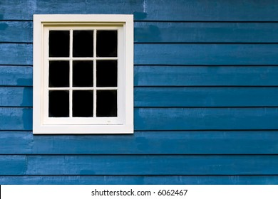 Blue wall with white window frame