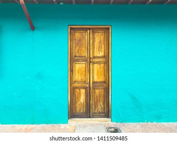 Blue walls and yellow wooden doors