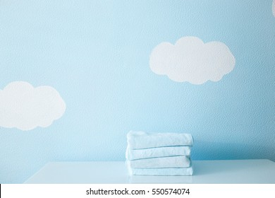Blue washcloth on the table on blue sky background