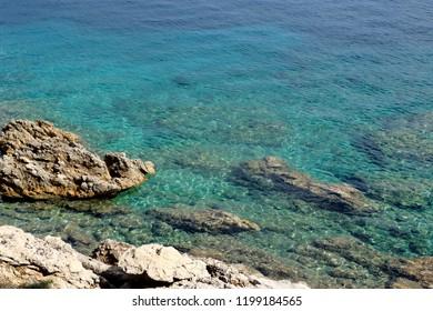 blue water in a bay between Mali and Veli Losinj, Croatia