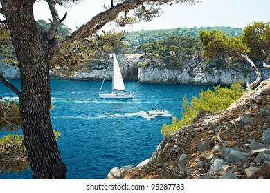 Blue water and boat in Calanque de Cassis, Mediterranean France, region PACA