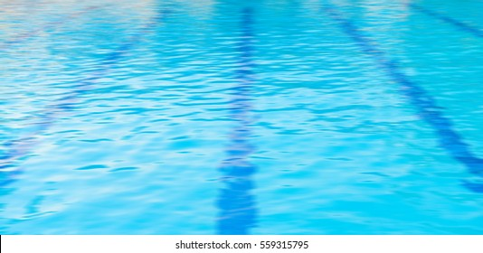 Blue water and laens in swimming pool