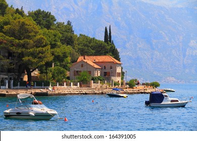 Blue water and old town on shores of the Adriatic sea