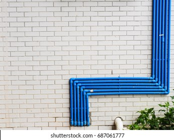 blue water pipe on the white wall