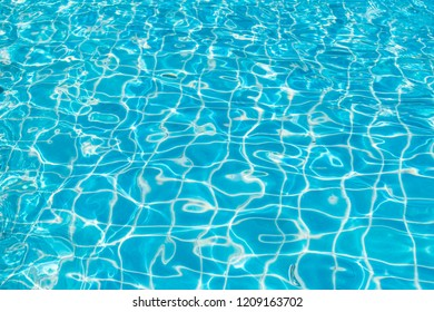 Blue water in pool for background and abstract, Ripple wave with sun reflection in swimming pool