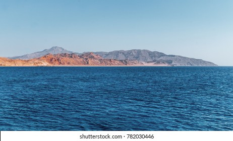 Blue water of the Red Sea and deserted shore