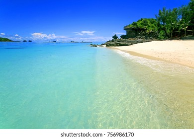 Blue water and sky, yellow and white beach of Emerald Sea, Madagascar, Indian Ocean