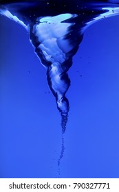 Blue water spiral of water swirling around in a studio