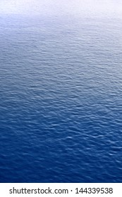 Blue water surface with brightness in the distance