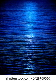 Blue water surface with mirrow of moon's light