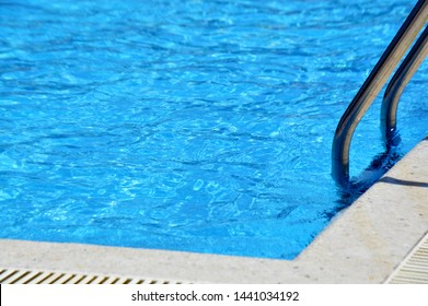 Blue water surface in the swimming pool. Summer vocation and relax concept