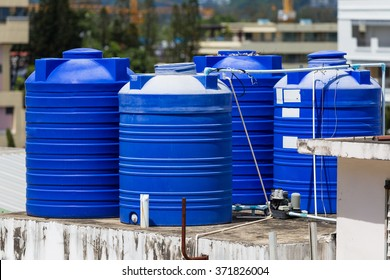 Blue water tanks of industrial building on roof top or deck in Phuket