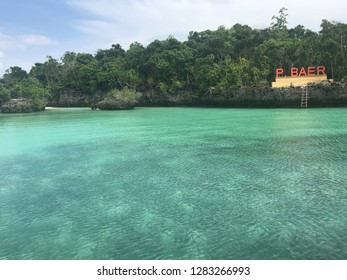 Blue watercolor beach with clear underwater in Baer Island, Kei Island, Indonesia