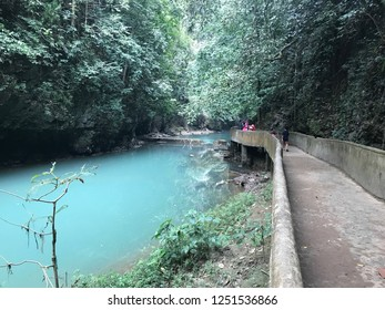 Blue watercolor river surrounded by small forest in Bantumurung waterfall, South Sulawesi Indonesia