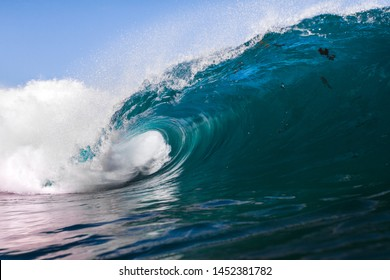 blue wave crashing on a shallow reef