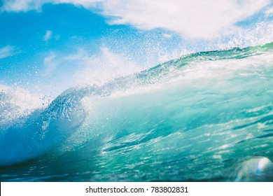 Blue wave in ocean. Breaking wave and sun light