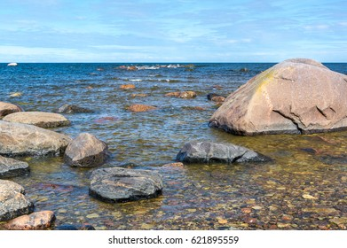 blue waves at seaside and rocks