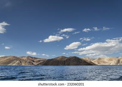 Blue wavy surface of high mountain lake