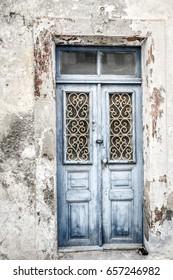Blue Weathered Wood Paneled Door with Decorative Window  Lattice