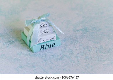 Blue wedding background. Wedding tradition : something old, new, borrowed and  blue. Sky blue background with copy space for text. Flat lay. Blank stationary template / invitation mockup.